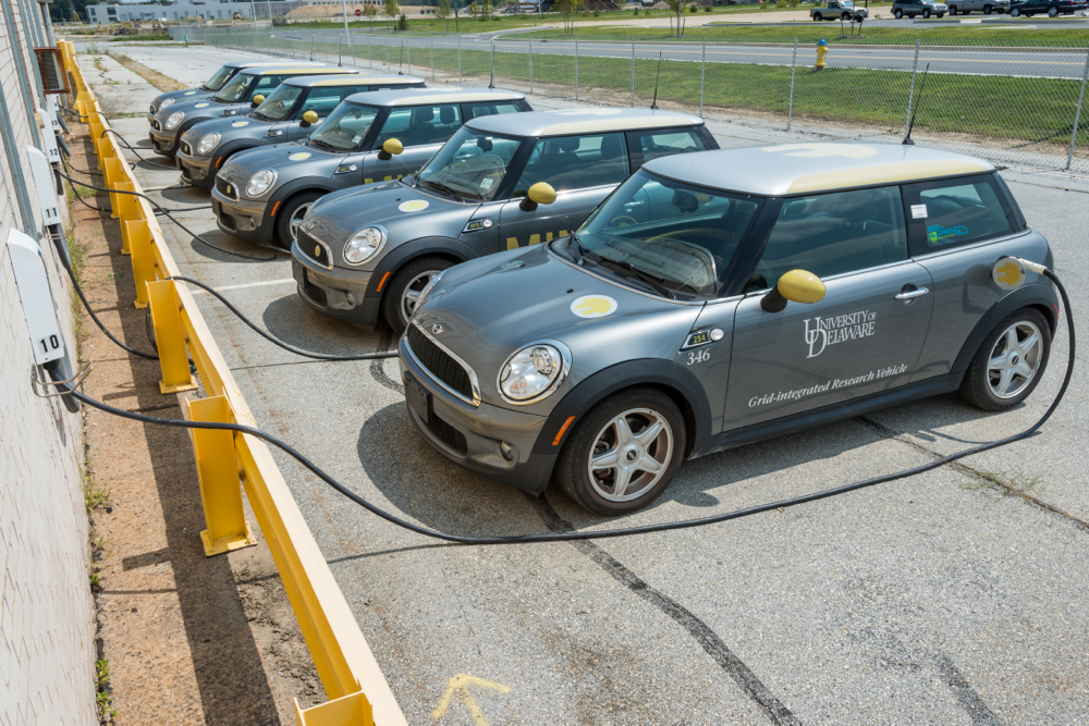 University of Delaware under Dr. Willett Kempton has demonstrated the environmental and economic benefits of vehicle to grid (V2G) through pilot programs like a fleet of 15 BMW Mini Coopers participating in PJM's ancillary service markets for frequency regulation.